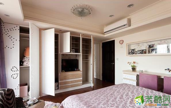 卧室 全包覆式电视柜蕴含风水及大收纳容量。 133平现代风格装修效果图-永丰装饰